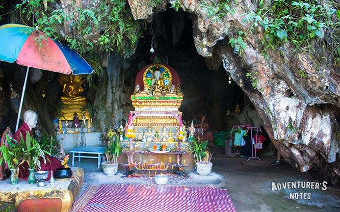 The Buddha and The Monk statues at the entrance to the cave Tham Sao Hin Payanak